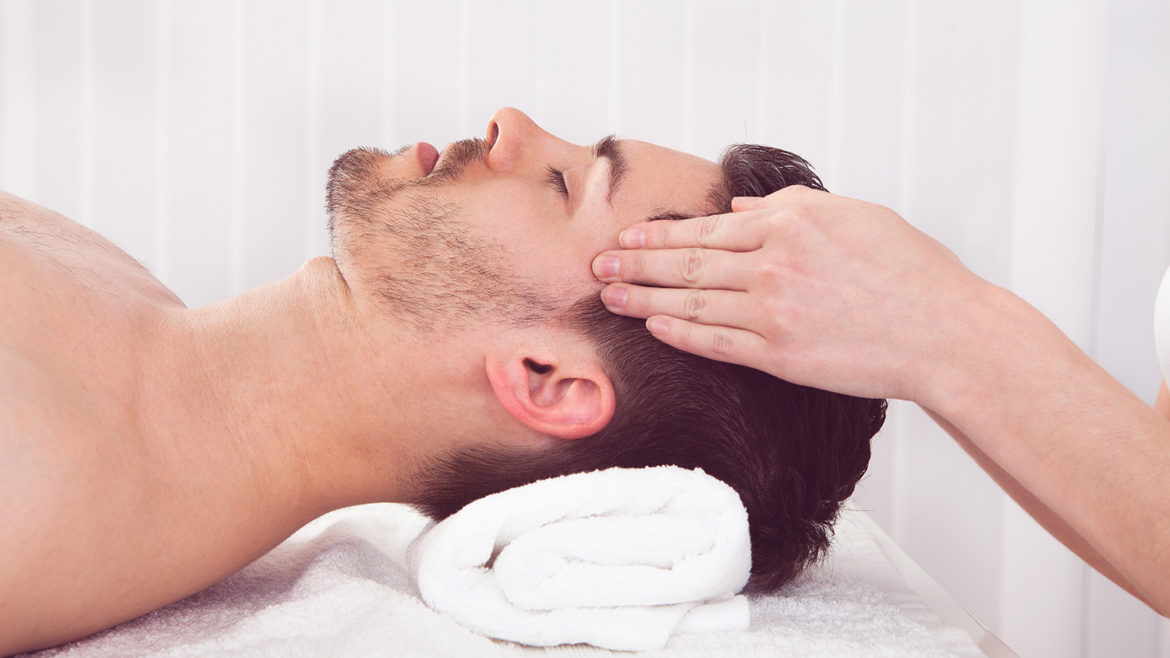 Man getting massage in spa centre